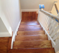Old wood stairs in a historic Springfield home after refinishing