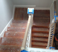 Old wood stairs in a historic Springfield home before refinishing