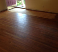 Area of sanded old Red Oak wood flooring, near the door