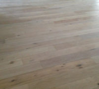 Engineered white stained White Oak wood flooring for a beach house look