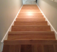 Finished and installed solid White Oak stair treads