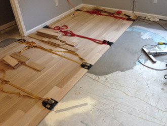 Install sand and finish white oak premium grade wood flooring in pvb installing wood flooring with adhesive and flooring straps ppazfo