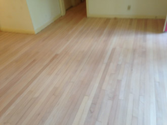 old clear grade solid red oak flooring after sanding