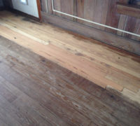 One pass with sander reveals character of solid Heart Pine wood floor
