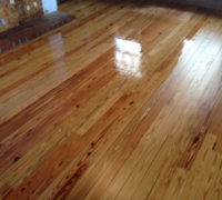 Sanded solid Heart Pine wood floor during refinishing