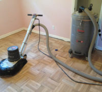 Sanding the DIY refinished parquet wood floor
