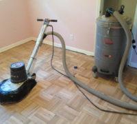 Sanding the DIY refinished parquet wood floor