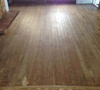Solid Heart Pine wood floor before refinishing