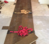 Special straps hold wide wood flooring planks together during installation