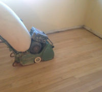 Vacuum sanding solid Red Oak wood flooring