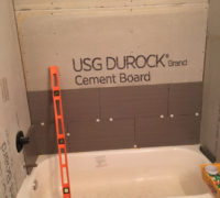Installing wood look tile - tub & shower surround