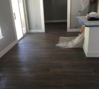 Wood look floor tile installed