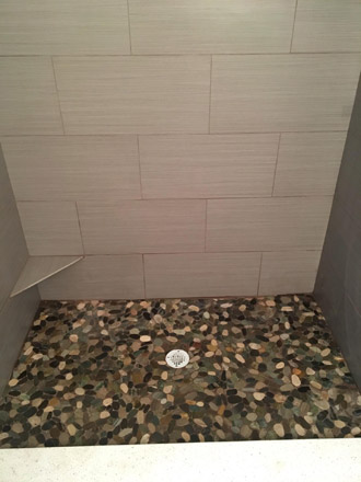 Wood Look Tile On Standup Shower Walls With River Rock Floor
