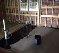 Installing visqueen vapor barrier on concrete slab