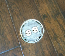 New hickory wood flooring with in-floor electrical outlet