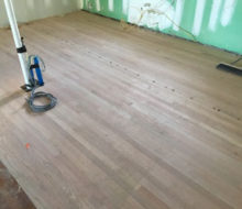 Red Oak wood flooring with nickels installed to make expansion joints