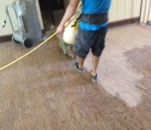 Sanding the wood floor landing