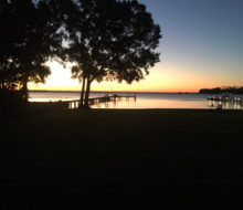 Sunset view of the pier behind client's home on the St. Johns River