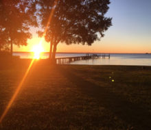 Sunset view of the pier behind client's home on the St. Johns River - Avondale