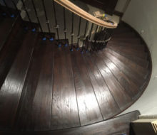 View of refinished stairs and edge of landing from landing