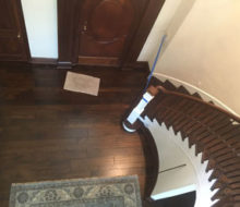 View of variable width solid Hickory wood flooring and refinished stairs from refinished landing.