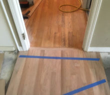 Aligning new red oak flooring with existing wood flooring planks