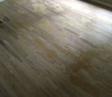 Applying Red Oak filler to installed new Red Oak flooring