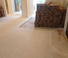 Boxes of Bella Cera French Oak wood flooring where carpeting has been removed
