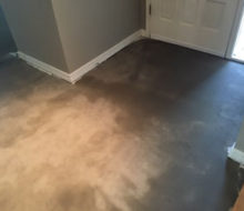 Concrete slab foyer subfloor after tile removed