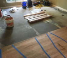 Installing rotary sawn Red Oak flooring on leveled concrete slab