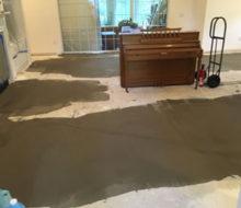 Leveling concrete subfloor
