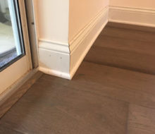 New baseboards and shoe molding with installed French Oak wood flooring