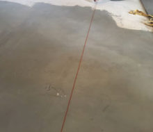 Snapping a chalk line on leveled subfloor while installing French Oak wood floor