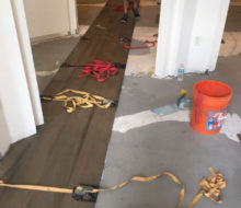 Special flooring straps hold wide planks together during installation