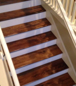 Stained and finished new birch stair treads in place