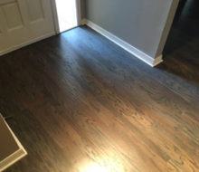 Stained and finished, rotary sawn Red Oak wood flooring