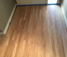 Unfinished, rotary sawn Red Oak wood flooring in foyer