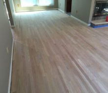 Unfinished, rotary sawn Red Oak wood flooring installed