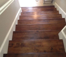 View of lower portion of stained and finished Birch stair treads from above