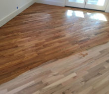 Applying golden oak stain to red oak wood flooring