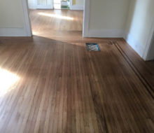 Face nailed white oak flooring with walnut strip border after refinishing