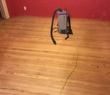 Face nailed white oak flooring with walnut strip border and vacuum after sanding and hand scraping