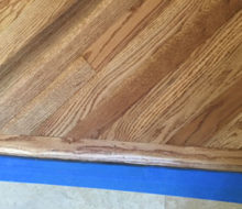 Header board for diagonal sanded and stained red oak wood flooring
