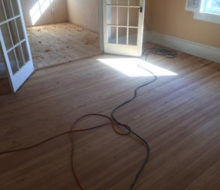 Old heart pine wood flooring after sanding and hand scraping