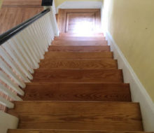 Old heart pine stair treads and white oak landing after refinishing