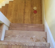 Sanding and hand scraping old heart pine stair treads