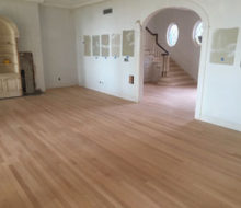 After sanding red oak wood floor and stair treads
