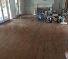 Dan's Floor Store gear on old red oak wood floor