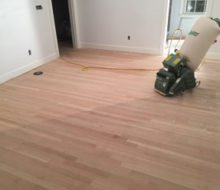 Lagler-Hummel belt sander on sanded red oak wood floor