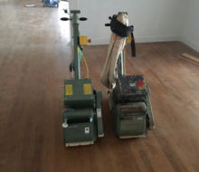 new and old Lagler-Hummel belt sanding machines, side by side